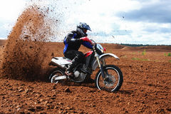 Off-road motorbike driving in dirt. Royalty Free Stock Photography