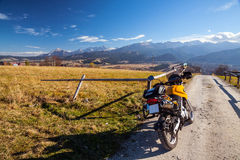 Off-road motorcycle in mountains scenery Royalty Free Stock Photography