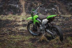 Off-road motorcycle parked in field Royalty Free Stock Images