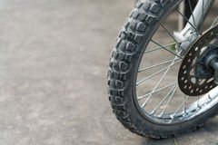 Off-road motorcycle tires. Off-road motorcycle tires on dusty ground. Selective focus on the front part Stock Images