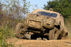 Off-road in mud. Muddy off-road vehicle crossing terrain royalty free stock photography