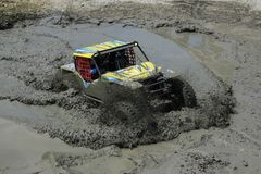 Off Road Mudflow Puddle in Summer Competition. Yogyakarta, Indonesia, 14/05/2017: Adrenaline sports an offroad car cross a dirty mud puddle in a summer stock photography