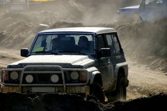 Off-road racing. A four-wheeled vehicle taking part in an off-road race Stock Photography