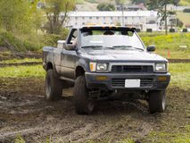Off Road Racing. A truck racing through the mud in an off road competition. Slight motion blur Royalty Free Stock Images