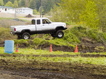 Off Road Racing. A truck racing through the mud in an off road competition. Slight motion blur Stock Image