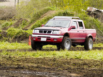 Off Road Racing. A truck racing through the mud in an off road competition. Slight motion blur Royalty Free Stock Image