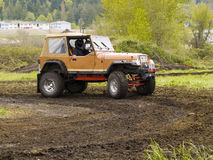 Off Road Racing. A truck racing through the mud in an off road competition. Slight motion blur Stock Photo