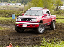 Off Road Racing. A truck racing through the mud in an off road competition. Slight motion blur Stock Photos