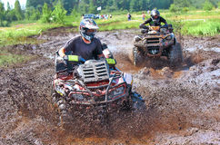 Off-road racing on ATV. ATV competition on mud off-road Stock Photography