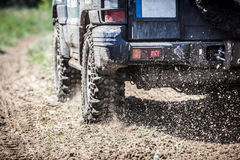 Off-road racing car zipping along a country road. Stock Photography
