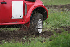 Off road rally puncture. Off road rally car makes a corner with a puncture royalty free stock photos