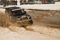 Off-road riding in the mud at the races Stock Photo