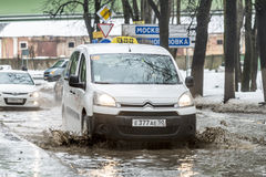 Off-road in Russia. The car rides on a deep puddle in the spring Royalty Free Stock Photos