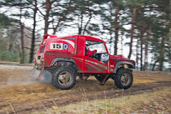Off road speed challenge. BAGSHOT, UK - MARCH 24: An unnamed driver competing in the UK SCOR off road championships takes a tight & icy right handed corner at Stock Image