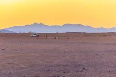 Off road SUV car in Arabian desert royalty free stock photography