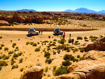 Off-road SUV with tourist on Altiplano Royalty Free Stock Photography