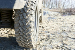 Off-road tire. The aggressive tread pattern. Installed on the Niva SUV stock image