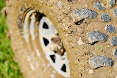 Off road tire full of mud Stock Photo