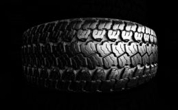 Off-road tire isolated on black stock photo