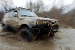 Off-road tourism. Overcoming the river in the ford royalty free stock photography