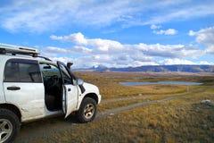 Off-road tourists car on famous mountain Plateau Ukok, Altai Royalty Free Stock Photo