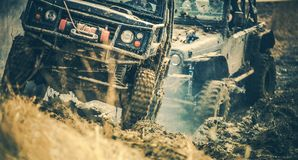 Off Road Trail Expedition. Two Sport Utility Vehicles Covered in Mud on the Rural Road royalty free stock image