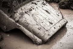 Off-road Trophy car UAZ 469 stucks in deep mud. Royalty Free Stock Images