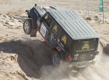 Off-road truck competing in a desert rally Royalty Free Stock Photo