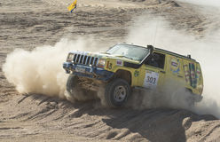 Off-road truck competing in a desert rally Royalty Free Stock Photos