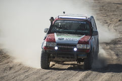 Off-road truck competing in a desert rally Royalty Free Stock Image