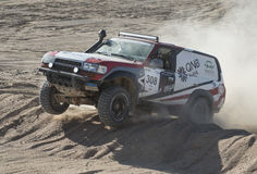 Off-road truck competing in a desert rally Stock Photos