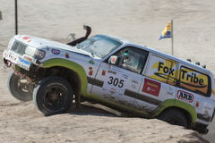 Off-road truck competing in a desert rally Stock Images