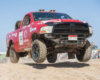 Off-road truck competing in a desert rally Royalty Free Stock Images