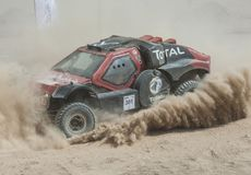 Off-road truck competing in a desert rally Royalty Free Stock Photography