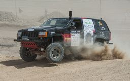 Off-road truck competing in a desert rally Stock Image