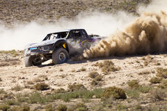 Off Road Truck Race with Dust Plume Stock Photography