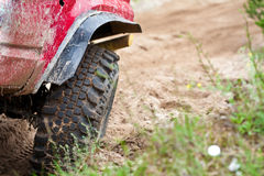 Off road truck in trial competition. Closeup of 4x4 truck tire on sand track Stock Photos