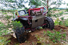 Off road truck in trial competition. Closeup of 4x4 truck driving uphill with winch Stock Images