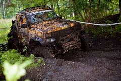 Off road truck in trial competition. Pickup 4x4 truck driving trough mudy track Stock Photography