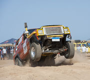 Off-road trucks competing in a desert rally Royalty Free Stock Photography