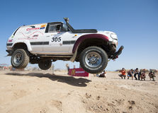 Off-road trucks competing in a desert rally Royalty Free Stock Images