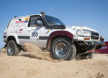 Off-road trucks competing in a desert rally Stock Images