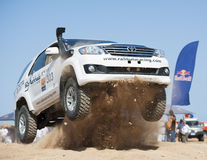 Off-road trucks competing in a desert rally Stock Photos