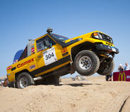 Off-road trucks competing in a desert rally Stock Photo