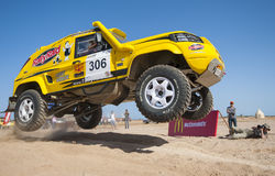 Off-road trucks competing in a desert rally Royalty Free Stock Photos