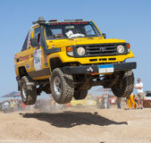 Off-road trucks competing in a desert rally royalty free stock image