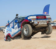 Off-road trucks competing in a desert rally Royalty Free Stock Photo