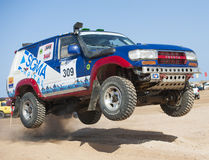 Off-road trucks competing in a desert rally Stock Photography
