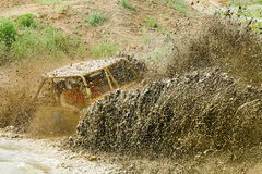 Off road vechile on the rally race Lijak 2015. Off road vechile in the mud on the 4x4 rally race Off Road Lijak 2016 at Vogrsko, Slovenia Royalty Free Stock Images
