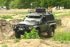 Off road vehicle. A four-wheeled Nissan vehicle at an off-road competition Royalty Free Stock Photography